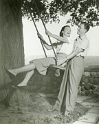 Young Adult Framed Prints - Couple Playing On Tree Swing Framed Print by George Marks