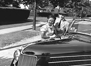30-39 Years Framed Prints - Couple Posing At Open Top Car, (b&w), Portrait Framed Print by George Marks