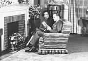 Mature Women Posters - Couple Sitting On Armchair In Front Of Fireplace, (b&w) Poster by George Marks