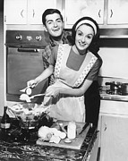 30-39 Years Posters - Couple Standing In Kitchen, Smiling, (b&w) Poster by George Marks