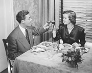 Heterosexual Couple Framed Prints - Couple Toasting At Dinner Table, (b&w), Elevated View Framed Print by George Marks