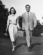 Serene People Posters - Couple W/ Picnic Basket Poster by George Marks