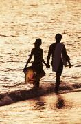 Surf Silhouette Prints - Couple wading in ocean Print by Larry Dale Gordon - Printscapes