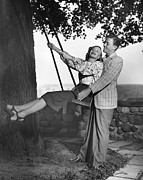 Serene People Posters - Couple W/woman On Swing Poster by George Marks