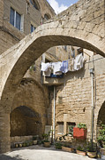 Mideast Posters - Courtyard with Drying Laundry Poster by Noam Armonn