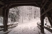 Snow Drifts Photos - Covered Bridge by Michael McGowan