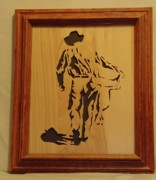 Woodcarving Sculpture Originals - Cowboy and Saddle by Russell Ellingsworth