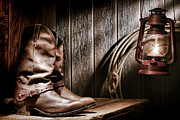 Spurs Prints - Cowboy Boots in Old Barn Print by Olivier Le Queinec
