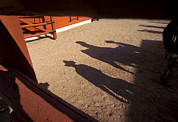 Carefree Arizona Art - Cowboy shadows and a by Raul Touzon