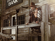 Poncho Photo Framed Prints - Cowboy Waiting Outside of a Bank Building Framed Print by Oleksiy Maksymenko