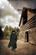 Leather Coat Posters - Cowboy Walking by Barn Poster by Jill Battaglia