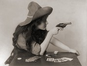 Revolvers Photos - Cowgirl With Deck Of Cards And Chips by Everett