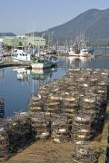Crab Traps Photos - Crab Traps On A Pier Near Fishing Boats by Michael Melford
