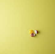Yellow Background Posters - Cracked Egg On Yellow Background Poster by Mark Lund