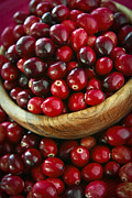 Wooden Bowl Framed Prints - Cranberries in a bowl Framed Print by Elena Elisseeva