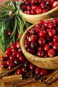 Cranberry Photo Prints - Cranberries in bowls Print by Elena Elisseeva