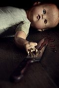 Abducted Prints - Creepy doll with bloody knife  Print by Sandra Cunningham