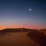 Dawn Posters - Crescent Moon Over Dunes Poster by Photo by John Quintero