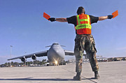 Crew Chief Marshals A C-5 Galaxy Print by Stocktrek Images
