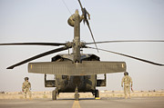 Airfield Prints - Crew Chiefs Stand Beside Their Uh-60l Print by Terry Moore