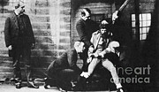 New York Cops Framed Prints - Criminal Being Held Down For Mug Shot Framed Print by Photo Researchers