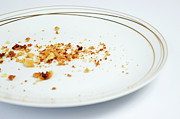 Finishing Posters - Crumbs in white plate Poster by Sami Sarkis