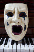 Masks Posters - Crying mask on piano keys Poster by Garry Gay