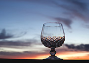 White Wine Photo Framed Prints - Crystal Glass against Sunset Framed Print by Blink Images