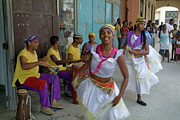Street Performers Prints - Cuban band Los 4 Vientos and dancers entertaining people in the street in Havana Print by Sami Sarkis