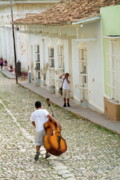 Double Bass Posters - Cuban man carrying a cello Poster by Sami Sarkis