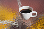 Glass Table Prints - Cup of Coffee on a Textured Glass Table Print by Thom Gourley/Flatbread Images, LLC