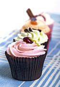 Frosting Photo Posters - Cupcakes on tablecloth Poster by Jane Rix