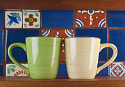 Two Coffee Cups Framed Prints - Cups in Front of Colorful Tile Framed Print by Thom Gourley/Flatbread Images, LLC