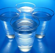 Detoxification Prints - Cups Of Water Print by Tek Image