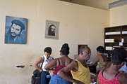 Che Guevara Prints - Customers at a pharmacy with Che Guevara portraits on the walls in Cuba Print by Sami Sarkis