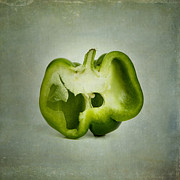 Filled Posters - Cut green bell pepper Poster by Bernard Jaubert