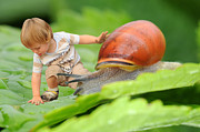 Lifestyle Digital Art Prints - Cute tiny boy playing with a snail Print by Jaroslaw Grudzinski