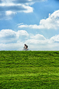 Grassy Hill Posters - Cycle Where Sky Meets Earth Poster by Bill Tiepelman