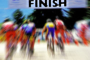 Bicyclists Posters - Cyclists Crossing the Finish Line Poster by Steve Ohlsen