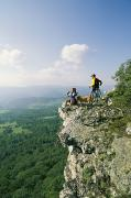 Scenic Overlooks Posters - Cyclists Relax On A Rock Outcropping Poster by Skip Brown