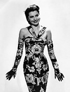Opera Gloves Posters - Cyd Charisse Modeling Flowered Evening Poster by Everett