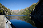Mountain Valley Framed Prints - Dam lake Framed Print by Mats Silvan