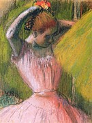 Pink Dress Framed Prints - Dancer arranging her hair Framed Print by Edgar Degas