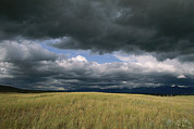 Bison Range Prints - Dark Clouds Gather Over A Prairie Print by Annie Griffiths
