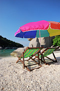 Beach Umbrella Prints - Deck Chairs On A Beach In Thailand Print by Thepurpledoor
