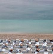 Empty Chairs Prints - Deck Chairs On Empty Beach Print by Axiom Photographic