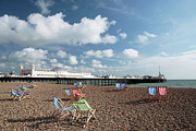 Brighton Beach Posters - Deckchairs on Brighton Beach Poster by Neil Overy