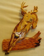 Intarsia Sculpture Framed Prints - Deer Jumping over a Log Framed Print by Russell Ellingsworth