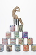 Canned Food Prints - Depressed mannequin on tin cans pyramid Print by Sami Sarkis