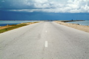 Sami Sarkis Metal Prints - Deserted rural road with the sea on either side Metal Print by Sami Sarkis